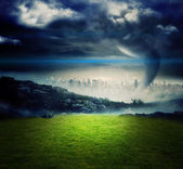 Tornado over city and moutains — Stock Photo