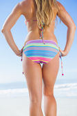Lower half of fit woman on beach — Stok fotoğraf