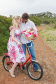 Couple going for a picnic kissing each other — Stock Photo