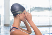 Swimmer by the pool fixing goggles — Stok fotoğraf