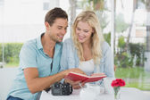 Hipster couple reading book together — Stock Photo