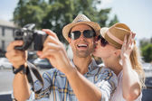 Hip couple taking a selfie with camera — Stock Photo