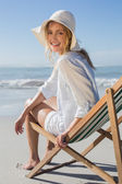Blonde relaxing in deck chair — Stock Photo