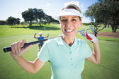 Golfer with partner cheering behind — Stock Photo