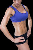 Strong woman in sports bra and shorts — Stock Photo