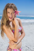 Blonde with flower hair accessory on beach — Stock Photo