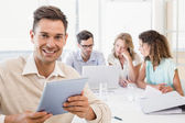 Businessman smiling during meeting — Stock Photo