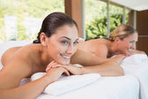 Friends lying on massage tables — Stock Photo