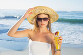 Blonde on the beach with cocktail — Stock Photo