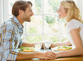 Couple enjoying a meal together — Stock Photo