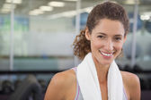 Fit woman with towel around shoulders — Stock Photo