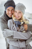 Cute couple in warm clothing — Foto de Stock