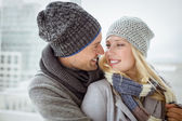 Cute couple in warm clothing — Stock Photo