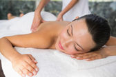 Brunette enjoying a back massage — Stock Photo