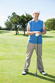 Cheerful golfer holding his club — Stok fotoğraf