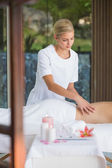Brunette enjoying a back massage — Stock Photo