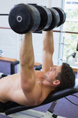 Bodybuilder lifting heavy dumbbells — Stock Photo