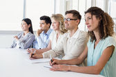 Business team listening during meeting — Stock Photo