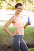 Woman holding water bottle in the park — Stock Photo
