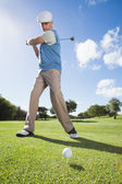 Golfer swinging his club on the course — Stock Photo