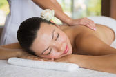 Brunette enjoying a peaceful massage — Stok fotoğraf