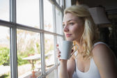 Blonde having coffee — Stock Photo