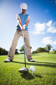 Golfer about to tee off — Stock fotografie