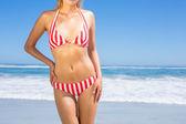 Fit woman in bikini on beach — Stock Photo