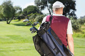 Golfer carrying his golf bag — Stock Photo