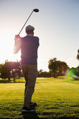 Golfer teeing off for the day — Stock Photo