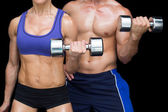 Bodybuilding couple posing with large dumbells — Stock Photo