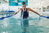 Swimmer doing the butterfly stroke — Stockfoto