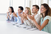 Business team clapping at presentation — Stock Photo