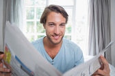 Man reading newspaper — Stock Photo