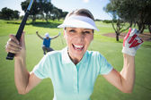 Golfer cheering at camera with partner — Stock Photo