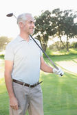 Smiling handsome golfer looking away — Foto Stock
