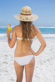Blonde in bikini sipping cocktail — Stock Photo