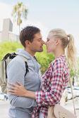 Tourist couple about to kiss — Stock Photo