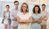 Business team with arms crossed — Stock Photo