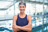 Pretty swimmer by the pool — Stock Photo