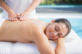 Brunette getting a massage poolside — Foto Stock