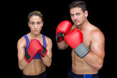 Bodybuilding couple posing with boxing gloves — Stock Photo