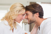Couple in bathrobes touching heads — Stock Photo
