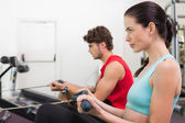 Brunette working out on the rowing machine — Stock Photo