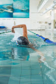 Fit swimmer doing the front stroke — Stock Photo