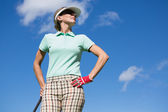 Female golfer standing with hand on hip — Stock Photo