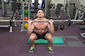 Bodybuilder lifting up barbell weight — Stock Photo