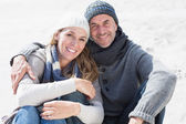Couple on the beach in warm clothin — Stock Photo