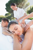 Couple enjoying couples massage — Stock Photo