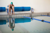 Fit swimmer ready to dive into the pool — Stock Photo